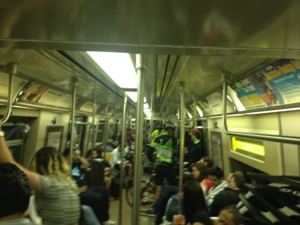 Mucking it on the A train heading to 168th street station with those heading home from a night out and a few steadfast cyclists. (may 18, 2014)
